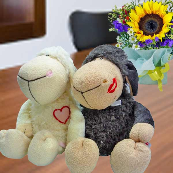 Couple sheep with Sunflower